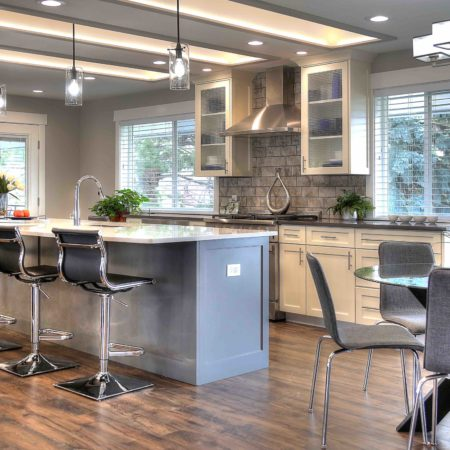 Ogden Contemporary Residential renovation, custom cabinetry, coffer ceiling, large kitchen island, white cabinetry, gray cabinetry, open concept, tile fireplace, bay window