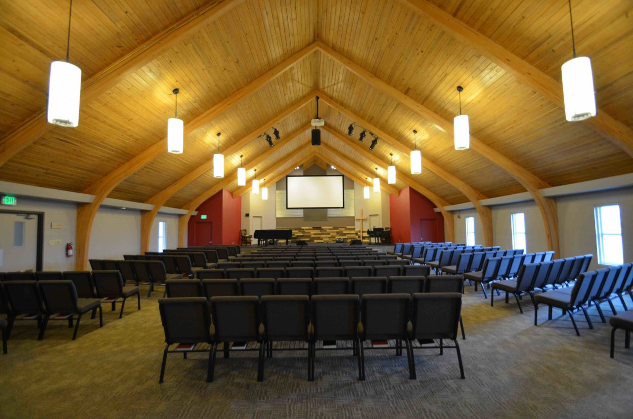 Calvary Community Baptist Church renovation Colorado. Mountain West Architects. Simple church design, simple church layout, minimalistic church layout, pendant lighting, exposed wood rafters in churches, wood ceiling in church