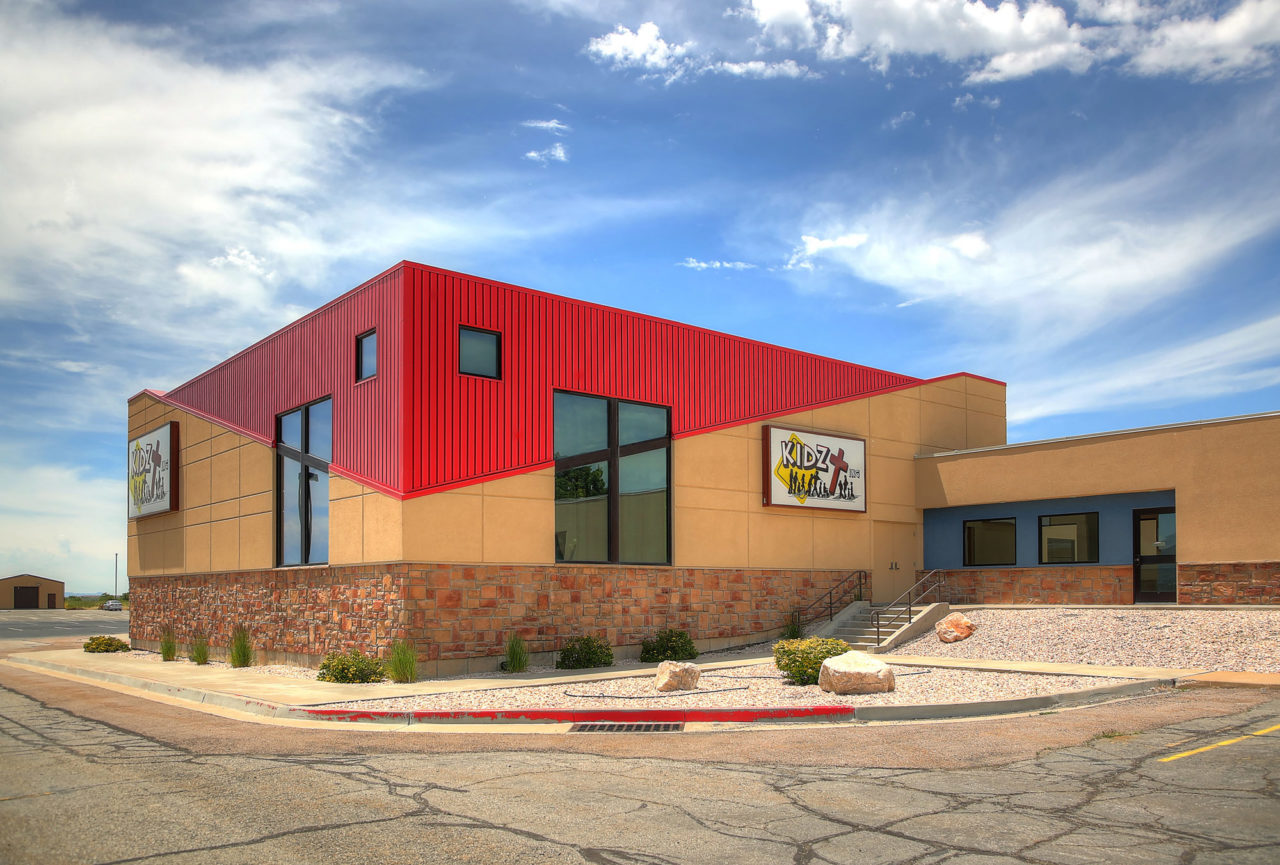 Washington Heights Addition in Ogden, UT - stucco siding with score lines - Kids zone churches - tall windows - diagonal lines in buildings