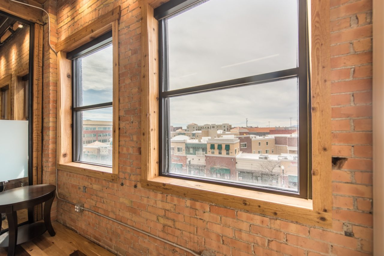 Renovated office. Glass partition walls. Family Business Center. Urban industrial design.
