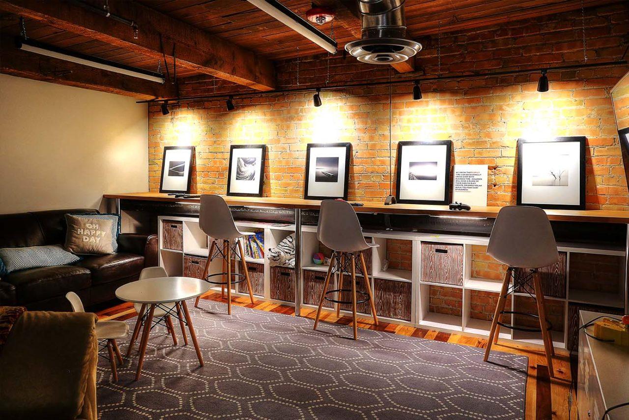 Cozy waiting area, warm spot lights, brick interior walls, warm color scheme
