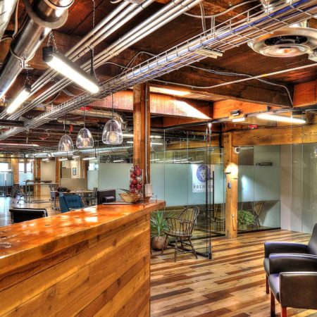Family Business Center, Ogden, UT, exposed ductwork, pendant light strips, pendant lights, exposed woodwork, warm color scheme office space, glass partition, window privacy glass
