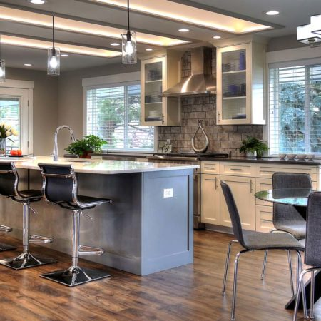 remodeled kitchens, pendant lights for kitchens, stone backsplash, modern seating in kitchen, marble countertops, flush mount lighting, kitchen skylights