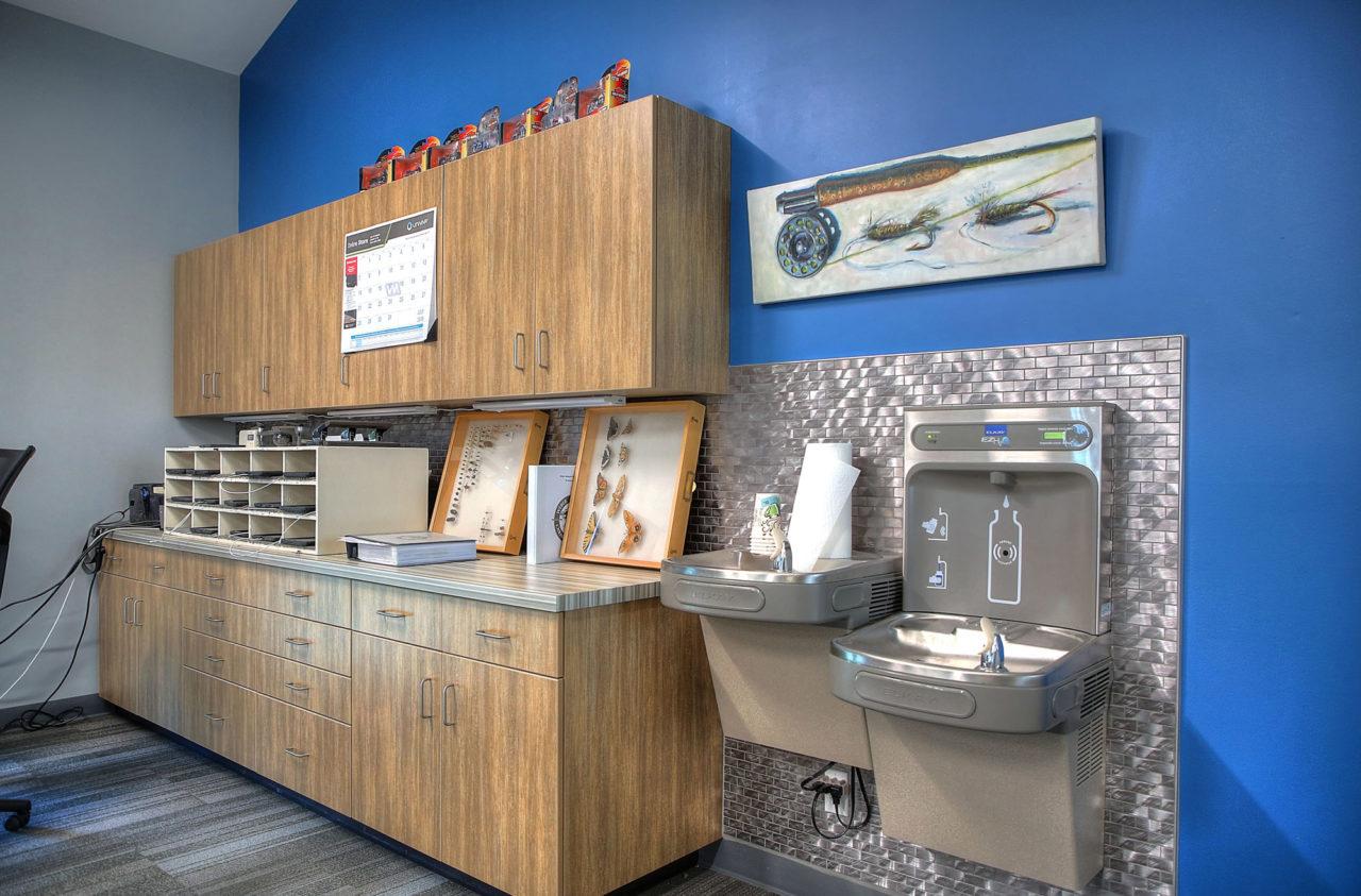 wood cabinetry, metal backsplash