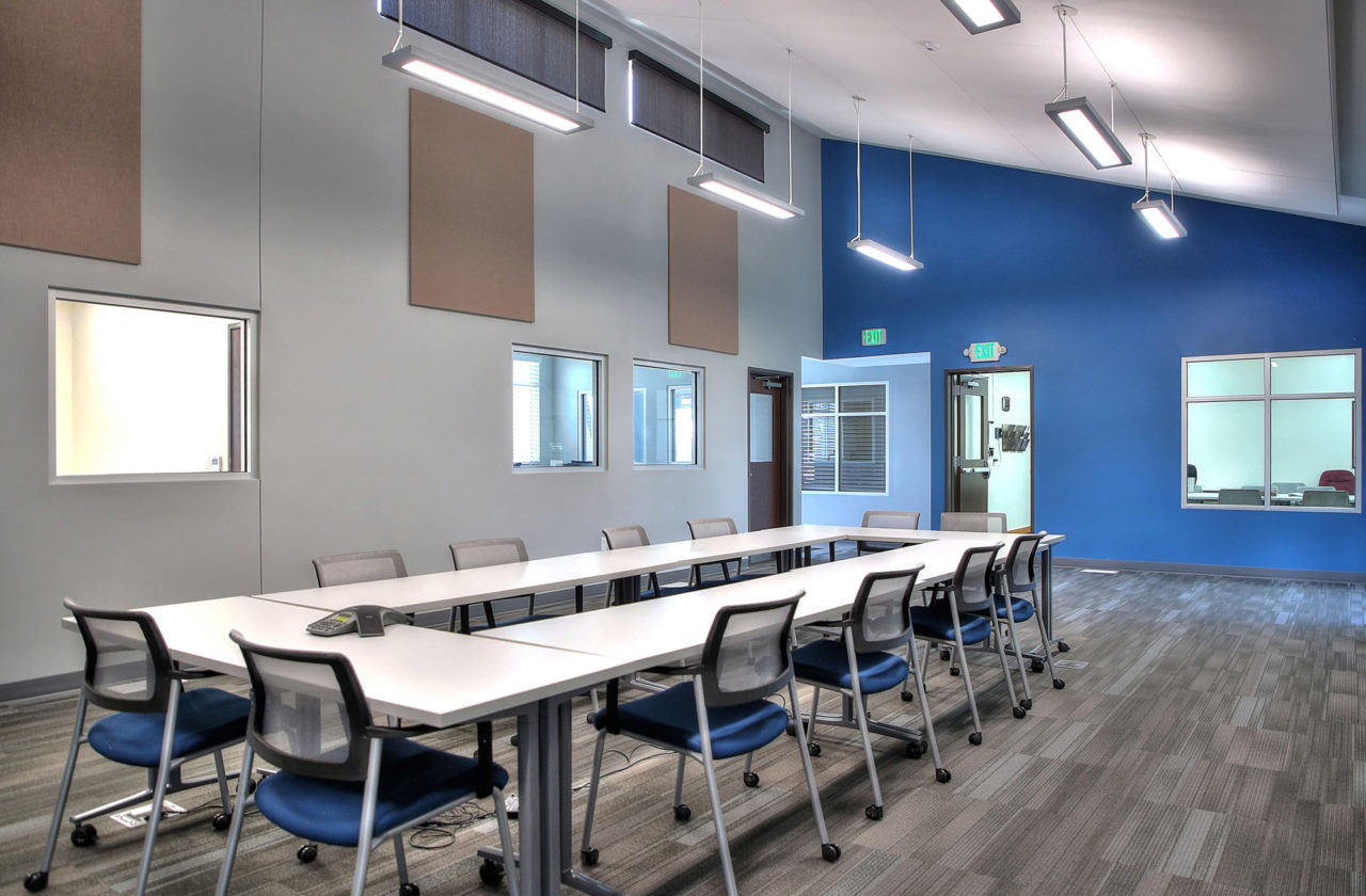 pendant light strips, cool interior colors, learning center interior layout, carpeted flooring